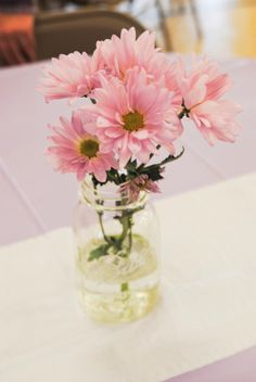 Purple diasies in a mason jar - simple and cute centerpiece table decoration Stick Pony Creations: Our Baby Girl's Baptism