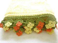 Yellow oya towel, via Flickr. Handmade 'Oya', Turkish lace edging, is often seen on traditional scarves. Oya creates a bright floral border of pink-ish orange, yellow and green to this yellow handtowel. Can be used in kitchen or bathroom, but pretty enough to display. Both short ends of towel have oya lace. Handwashing suggested