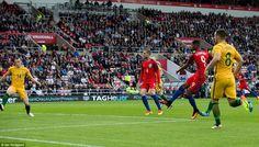 The 18-year-old slots the ball past Australia goalkeeper Mat Ryan to put England in the le...