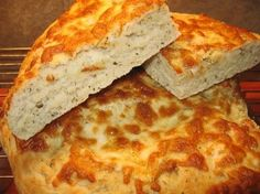 CHEESY FOCACCIA BREAD.    This looks fantastic.  It needs to have delicious REAL parmesean cheese melted on top of it to make it 100% absolutely perfect! :)