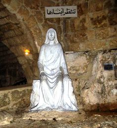 Magdhdouché, in the cave of Our Lady of Mantara, Lebanon. The adjacent hilltop where Jesus and Mary had once stood is now Sidon's Greek Catholic cemetery.