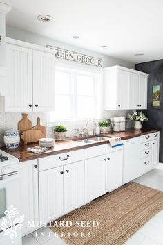 white kitchen with DIY butcher block counters | miss mustard seed