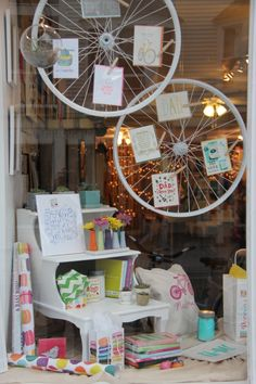 Window display using bicycle wheels at Poppins, Mackinac Island. #windowdisplay