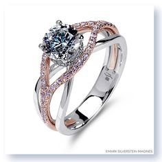 One of our most popular rings gets a makeover as this 18K white and rose gold engagement ring features one wispy diamond laced strand mixed with high polish strands intertwining together for a beautiful, elegant and feminine look. The ring features a halo of small diamonds surrounding and accentuating the center stone. #marksilversteinimagines