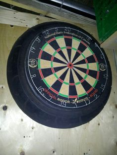 Man cave idea...took my old motorcycle tire and put my dart board in it ..