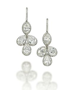 A PAIR OF DIAMOND EAR PENDANTS, BY MANUEL BOUVIER. Each set with a marquise-shaped diamond, weighing approximately 0.94 and 0.91 carat, suspending a trefoil of pear-shaped diamonds, weighing approximately 1.05 to 1.00 carat, to the micro pavé-set diamond surround and hook, mounted in gold
