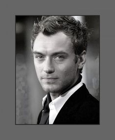 Jude Law's hair is cut in uneven layers that gives the messy trendy modern look - 2013 Hairstyles for Men with Balding Thinning Hair Style Cuts Trends