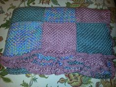 Finished! Loom knitted squares with double crocheted ruffle border! Made with Caron yarns, SO soft and cozy!