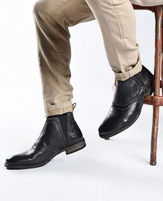 Black handmade boots by BEDSTU are always a classic staple. Style with a khaki rolled denim and hit the night on the town.