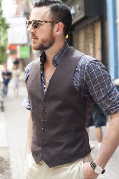 Great patterns and colors! The usual, probably need to roll down the sleeves and button the shirt up! Could work with a mid-tone color tie between the vest and shirt!