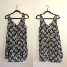 Floral Pattern Navy Dress High low style (shorter in the front and longer in the back). Sheer material, recommended wearing with a dark slip underneath. Would look great with tights. Size Medium and fits loosely. Dresses