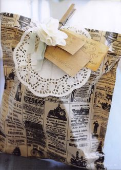 Glue two sheets of your favorite scrap booking paper together, let glue dry thoroughly, use 'fancy' scissors around edges, add whimsical fru fru to top of bag with a mini clothes peg.