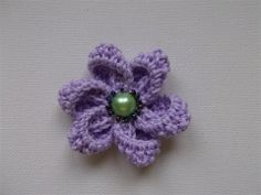 step by step pictures to show how to crochet this flower
