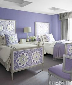 The regal hue certainly has a presence, but doesn't overwhelm this charming guest room.   - HouseBeautiful.com