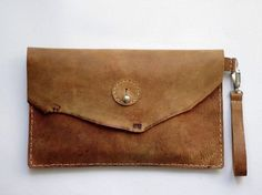 DIY tutorial: Sew A Leather Clutch Bag via DaWanda.com