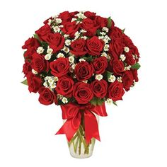Looking for a sure-fire way to tell that special person in your life how much they mean to you, how much you care, how wonderful they are? This is it. 36 vivid red roses as well as white Monte Casino blooms.  #valentinesflowers