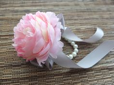 I wonder if I can recreate this with a real peony. I like the idea of using a pearl bracelet though Bracelet Corsage, Wrist Corsage, Pearl Bracelet, Grey Ribbon, Ribbon Colors, Prom Flowers, Wedding Flowers, Burgundy And Grey Wedding, Pink Peonies