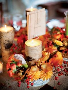 Birch Wood Candle Centerpieces but instead of the red and orange flowering do hydrangeas or lilacs