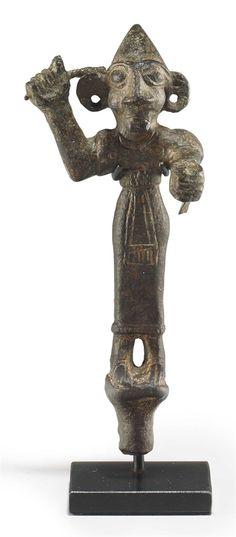 A CANAANITE BRONZE FIGURE MIDDLE BRONZE AGE II, CIRCA 1700-1500 B.C.  | Christie's