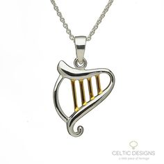 Sterling silver Celtic harp pendant with yellow gold string details.