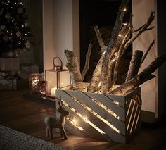 No fire? No problem! Create your own fire-y focal point with some rustic logs and fairy lights in a slatted box. Struggling with tangled fairy lights? Don't waste your time untangling - add some rustic logs or twigs in a slatted box. #FlavoursofXxmas