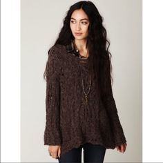 """Free People Fluted Cable Pullover in Brown Beautiful free people sweater! So in love and not sure I'm ready to sell. Very versatile! Third pic is for style ideas-layer it over your favorite FP thermal with the sleeves rolled up, or just simply over a trapeze slip! Only worn a few times by previous owner and once by me.  """"Beautiful cable knit pullover sweater tunic. Bell sleeves. High-low style. Super soft fabric. *45% Cotton, 19% Acrylic, 14% Nylon, 12% Wool, 8% Rayon, 2% Alpaca"""" Free People…"""