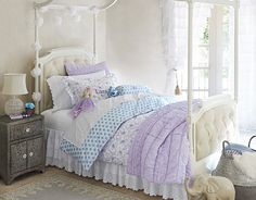 I love the Pottery Barn Kids Lara on potterybarnkids.com Again, we both like this.  Colors purple and aqua together are seemingly our favorites.