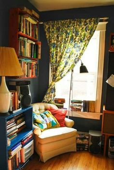 Books, cozy spot at a window, wooden floor and nice colours (rustic blue)