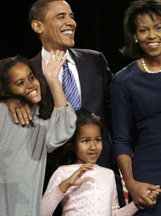 Then-presidential hopeful Barack Obama waves to supporters