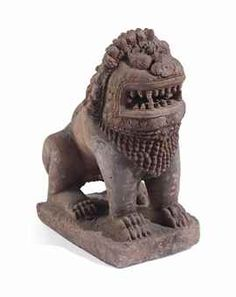 A FINE SANDSTONE LION CAMBODIA, KHMER, KOH KER PERIOD, 10TH CENTURY Carved in squatted posture on a rectangular plinth, his head with open mouth showing teeth and fangs, with bulging eyes, the curls of the mane cascading down the back, with upturned tail carved over his back 28 ½ in. (72 cm.) high