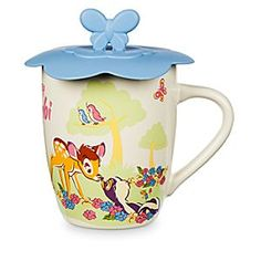 Bambi Mug with Lid   Disney Store Bambi and Flower rub noses, while Thumper dances atop a log on the sweet scene that circles this ceramic cup. Inspired by Walt Disney's animated classic, this <i>Bambi</i> mug includes a flexible lid to keep contents warm and prevent spills.