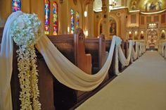First 8 rows of aisle will be draped and will have a single hydrangea with white satin ribbon attached to the pew.
