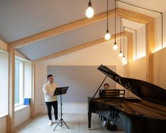 The architects chose materials to respect the building's Arts and Crafts style, as well as the character of the surrounding conservation zone. Timber Panelling, Timber Beams, Student Bedroom, Rehearsal Room, Acoustic Design, Terrazzo Flooring, Minimal Home, London House, Study Areas
