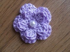 Free Five Petal Crochet Flower from Busy Bees Craft Place. (Pattern not on Ravelry.)