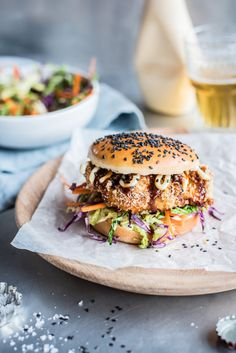 Chicken Katsu Burger - Crispy baked panko chicken with Japanese mayonnaise, Tonkatsu sauce and a crunchy sesame slaw. Japanese mayonnaise and Tonkatsu sauce are available at good Asian grocers. Baked Panko Chicken, Crispy Chicken Burgers, Chicken Burger Recipes, Good Food, Yummy Food, Tasty, Tonkatsu Sauce, Beste Burger, Sandwiches