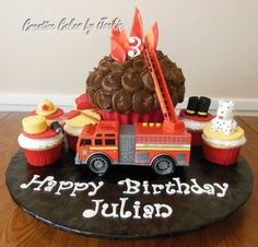 The Julian  Fireman themed Giant Cupcake w/6 matching regular cupcakes Menu Choice: Ooh La La French & Chocolate Dreams with fondant & gumpaste accessories.  If this was your cake please comment on it and let me know what you thought of it. Share, like and love this photo but please do not take out the watermarks.   For a quote on this cake please text 903-815-7633 or message me here or email at creativecakesbyj@gmail.com