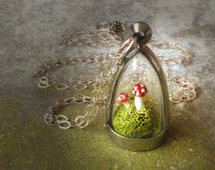 Terrarium Moss Toadstool Necklace. The Enchanted Faerie Mushroom Device of Doom. Sterling Silver Chain. via Etsy.