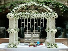 We love this white floral mandap, debuted for Tina and Kumar's wedding at the Gaylord Palms Orlando Resort. Designed by Occasions by Shangri-La.