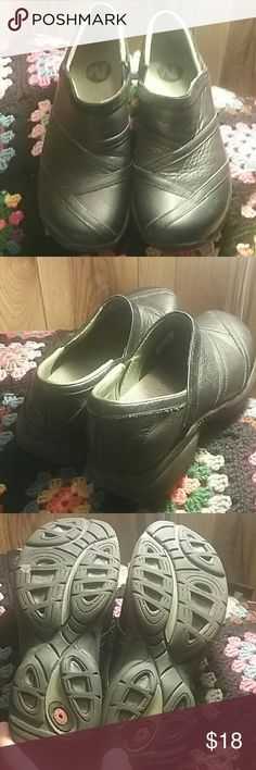 Merrell Slip on Everyday Shoes Black leather with patented, very clean rubber soles. Hardly worn. Great for shopping, the office, restaurant work, etc. No scuffs, soles are in excellent condition.  Merrells are well made and comfortable. Merrell Shoes