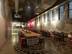 love the wall graphics, lighting and dining table on cinder block. #restaurant design Mejico