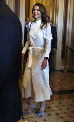 Queen Rania of Jordan in a stunning in a cream mock-neck blouse that she wore tucked into a calf-grazing tweed skirt.  The Queen's skirt was cinched at the waist with a cream sash, and she topped off her outfit with a pair of silver pumps, during their meeting in Washington, D.C.