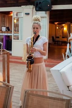 Hed Kandi's Lovely Laura on sax at an Ibiza Wedding. I'd probably choose Aimee Jay because I worked with her on tour in India!
