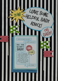 Custom invites, table signs, place cards and cupcake flags all help make the baby shower theme pop.