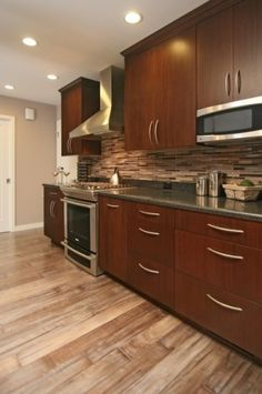 I have picked out a tile that has this look.  I am not really into the cabinets though.  The floor is nice.  I wonder if it is one of those new fabulous vinyls.  I prefer wood but if money is tight is could be a great choice.  Basement, Mudroom, lake house... you can get a vinyl floor that looks like this one.