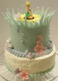 Tinker Bell Birthday Cake. looks like basically anyone in my life is going to need to take a decorating class so this can be made for my 30th birthday.