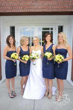 Navy bridesmaids - dresses from J Crew. Like bouquets too (bride = white and yellow, maids = just yellow)