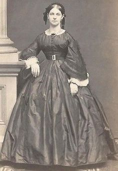 1860-1865 Silk day dress with ever present little white detachable collar, lace trimmed undersleeves  nice pattern of lace trim on dress sleeves. Note the popular pleated ribbon hair decoration; CDV