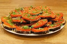 Eggplant slices in the oven with cheese and tomatoes