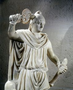 Statue of Mithras, ancient Persian god of light who was adopted into the Roman pantheon. Mithras is shown wearing the Phrygian cap. Louvre.