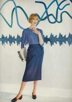 Jessica Ford, Harper's Bazaar, August 1957  Jessica is wearing a loose fitting sweater blouse and a wrap-around walking skirt in anglo wool tweed, by Sloat.
